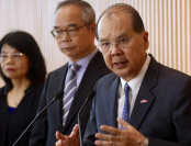 Hong Kong Chief Secretary for Administration Matthew Cheung Kin-chung (right), Secretary for Home Affairs Lau Kong-wah (center) meet the media at the Central Government Offices, Hong Kong, July 25, 2019. (EDMOND TANG / CHINA DAILY)