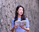 Seo Eu-ra, translator, author and YouTuber, poses in a recent interview with The Korea Herald. /Photo by Park Hyun-koo / The Korea Herald