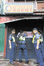 SHUTDOWN Police begin putting up notices on lotto outlets in Sampaloc, Manila, as President Duterte orders the closure of lotto and Small Town Lottery outlets nationwide, citing corruption in the PCSO. —MARIANNE BERMUDEZ