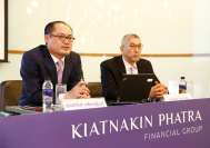 Aphinant Klewpatinond, left, chief executive officer of Kiatnakin Phatra Financial Group