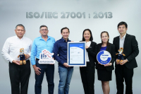 Nicolas Faquet, third from left, CEO and founder of Roojai.com, receives the Information Security Management System certification for online car and motorbike insurance sale system from Anongrat Chotikaprakal, third from right, customer services and sales manager of TÜV NORD CERT (Thailand). This achievement highlights the confidentiality, integrity and availability of Roojai.com's information management system.