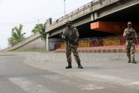 Indian paramilitary soldiers stand guard during a curfew in Jammu, the winter capital of Kashmir, India, on Monday.