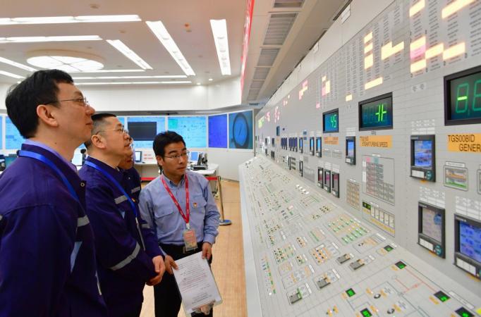 Technicians check data at the main control room of the Fuqing Nuclear Power Plant in Fuzhou, Fujian province. [Photo/Xinhua]