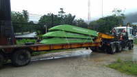 Flat-bottomed boats are moved to the Pak Jan Police Station compound in readiness to help with the evacuation of residents. The rising waters have forced residents to seek safer ground.