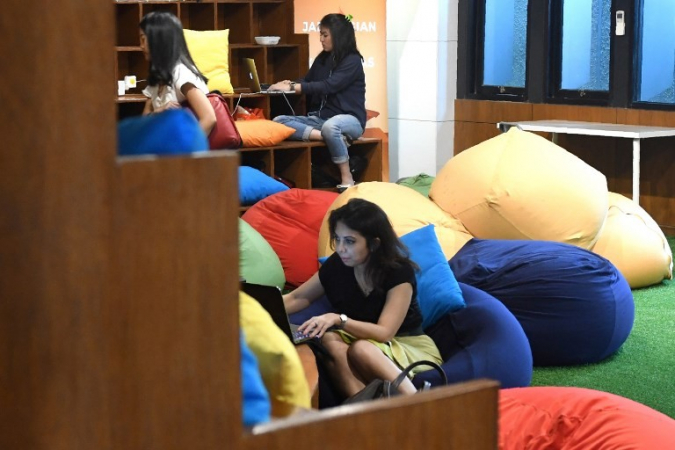 Entrepreneurs work digitally at the EV-Hive co-working space. (Photo: Agence France -Presse/Goh Chai Hin)