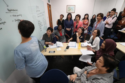 Senior Parliamentary Secretary for Manpower and Education Low Yen Ling (in pink blazer) observing a LifeWork course for mature workers with Centre for Seniors executive director Lim Sia Hoe (in pale grey, standing).ST PHOTO: TIMOTHY DAVID