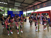 Dressed in their traditional costumes, Akha students of Ban Pana Sawan school perform the bamboo dance.