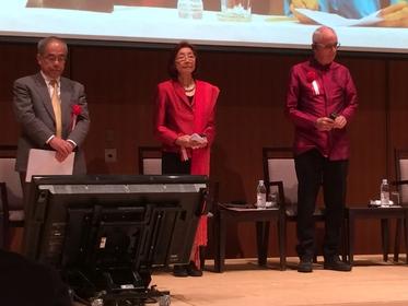 Pasuk Phongpaichit, second left, and Chris Baker, right, on stage at the Fukuoka Prize Symposium.