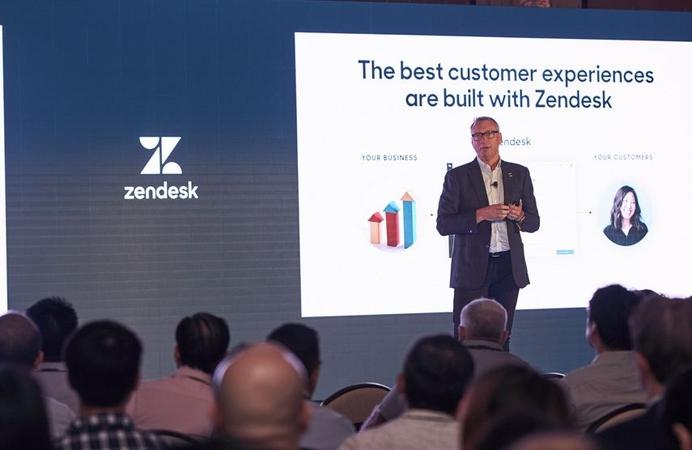 A Zendesk executive speaks at a company seminar.