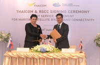 Patompob Suwansiri, right, Thaicom's Chief Commercial Officer, and Ksenia Drozdova, deputy director general of Russian Satellite Communications Company