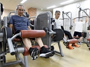 Elderly people work out at Tipness in Katsushika Ward, Tokyo. The gym is crowded with seniors during the daytime on weekdays.
