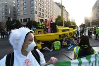 Protesters with a boat block the intersection of K Street N.W. and 16th Street N.W. in Washington during a climate protest on September 23, 2019. Washington Post photo by Matt McClain
