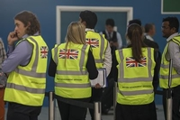 British government representatives wait to support travelers who have booked flights or holidays with Thomas Cook Group at the South Terminal of London Gatwick Airport near Crawley, England, on Sept. 23, 2019. Bloomberg photo by Chris Ratcliffe/Washington Post Syndication.