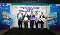 Cambodian Ambassador to Thailand Ouk Sophorn, together with Dr Seng Sakda from the Labour Ministry, second left, Chathip Ruchanaseree, Pathum Thani's vice governor, centre and Sukannee Lertsukwibul, chief of DTAC's prepaid market and product division, far right, announce plans to organise a big concert just for Cambodian migrant workers.