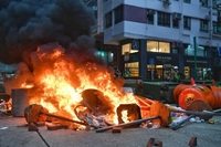 Protesters set a fire road block to slow police advancement at Wan Chai on Sept 29, 2019.ST PHOTO: CHONG JUN LIANG