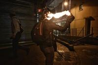 A protester throws a petrol bomb to light up a makeshift blockade in Hong Kong's Wan Chai district on Oct 4, 2019.ST PHOTO: CHONG JUN LIANG