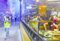 Diners in a Causeway Bay restaurant become upset as tear gas seeped into the diner on Friday night. Rioters took to the steets again after the government announced ban on mask-wearing at public assemblies.