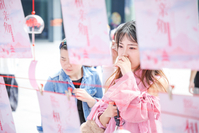 A girl reads a poster at a matchmaking event held by Alibaba Group at its headquarters in Hangzhou, Zhejiang province. There are more than 240 million singles in China, which has spawned a booming singles economy. [Niu Jing/for China Daily]