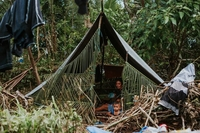 Survivors of the Maluku earthquake live in a makeshift tent in Negeri Oma, Haruku Island of Maluku on Oct. 1. (Antara/Baronda)