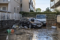 Vehicles lie damaged on Sunday after flooding caused by Typhoon Hagibis in Kawasaki, Japan. Photo: Getty Images