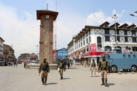 Security personnel enforce restrictions imposed by authorities in Srinagar. (File Photo: IANS)