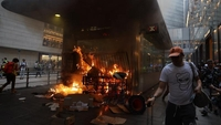 Fire rages at an exit of the Hong Kong subway's Central Station after radical protesters went on an arson spree on Sept 8, 2019. [PHOTO / CHINA DAILY]