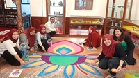 Festive preparations: Samford (fourth from left) with his staff members, who designed a kolam at Shah Beach Resort in Melaka.