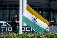 A staffer raises India's national flag outside the venue hosting the 35th Asean Summit in Nonthaburi province, Thailand, on Oct 30, 2019. PHOTO: EPA-EFE
