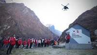 A group of rescue workers on Friday conduct a simulated rescue mission using a drone at the Machhapuchhre base camp, which is located 3,700 meters above sea level on Annapurna mountain in the Himalayas. KT