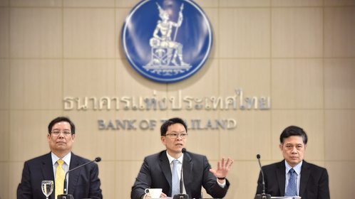 Central bank governor Veerathai Santiprabhob, centre, announces measures aimed at liberalising capital outflow to stem the baht's rapid rise in value.