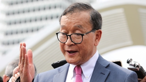Self-exiled Cambodian opposition party founder Sam Rainsy speaks to members of the media after visiting Parliament House in Kuala Lumpur on Nov. 12. (Reuters/Lim Huey Teng)