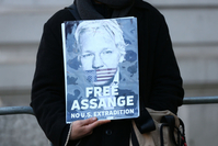 File photo: Wikileaks Founder Assange Attends Extradition Hearing  LONDON, ENGLAND - NOVEMBER 18: Julian Assange supporters demonstrate outside of the Westminster Magistrates Court on November 18, 2019 in London, England. (Photo by Hollie Adams/Getty Images)