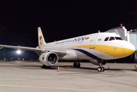 The photo shows a plane owned by Myanmar Airways International (MAI).