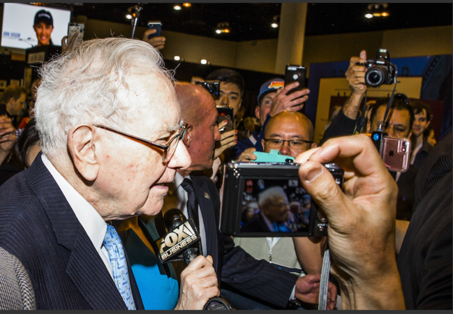 Warren Buffett, chairman and chief executive officer of Berkshire Hathaway Inc. (center) tours the shopping floor ahead of the Berkshire Hathaway annual meeting in Omaha, Neb., on May 5, 2018. MUST CREDIT: Bloomberg photo by David Williams.Photo by: David Williams — Bloomberg