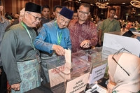Every vote counts: Dr Mahathir casting his vote at the Perkim 58th annual general meeting in Petaling Jaya. —Bernama