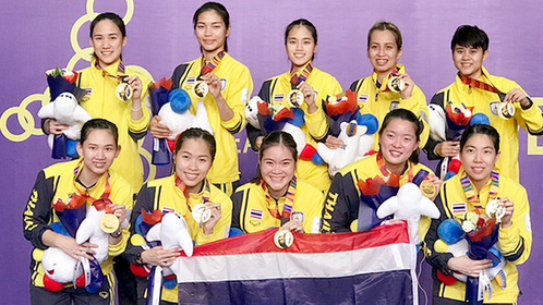 Thailand's badminton team with their gold medals.