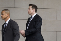 Elon Musk, CEO of Tesla Inc., arrives at federal court in Los Angeles on Dec. 3, 2019. MUST CREDIT: Bloomberg photo by Patrick T. Fallon.