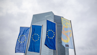 The stars of the European Union (EU) sit on banners flying outside the European Central Bank (ECB) headquarters in Frankfurt, Germany, on Nov. 27, 2019. MUST CREDIT: Bloomberg photo by Peter Juelich.