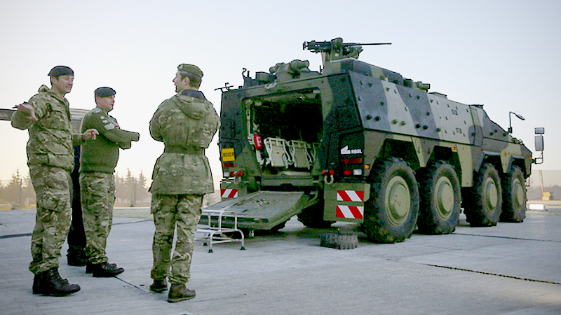 Soldiers stand guard near an armored vehicle on the perimeter of the NATO leaders' meeting near Watford, England, on Dec. 4, 2019. MUST CREDIT: Bloomberg photo by Hollie Adams.