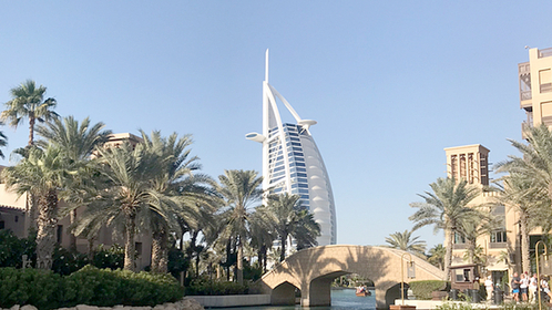 Tourists also enjoy taking pictures of the Burj Al Arab, a luxury hotel in Dubai that resembles a ship's sail.