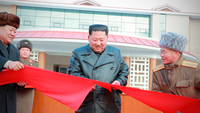 North Korean leader Kim Jong-un cuts a ribbon during a ceremony for the completion of the Yangdok County Hot Spring Cultural Recreation Center in North Korea in this undated picture released by North Korea's Central News Agency on Saturday. (KCNA)