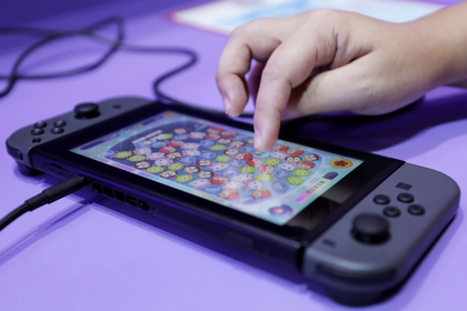 Nintendo could sell as many as four million Switch units in China in the fiscal year ending March and 12 million units of software, equity researcher Pelham Smithers estimates. MUST CREDIT: Bloomberg photo by Kiyoshi Ota