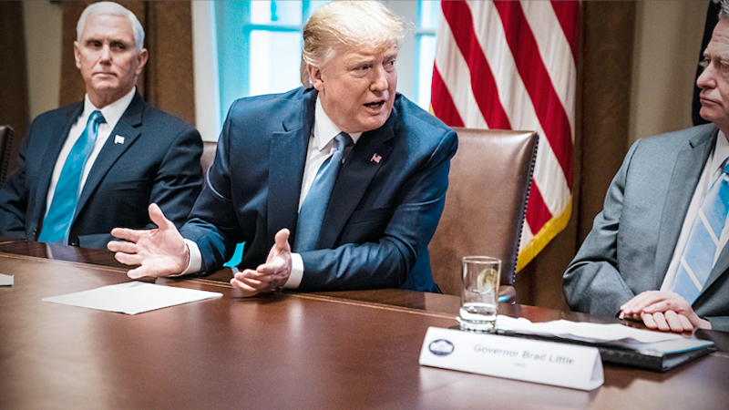 President Donald Trump, flanked by Vice President Mike Pence and Idaho Gov. Brad Little participates in a roundtable discussion at the White House on Dec. 16, 2019. MUST CREDIT: Washington Post photo by Jabin Botsford