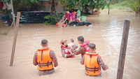 Rescuers evacuating residents in Johor on Dec 15, 2019.PHOTO: SIN CHEW DAILY