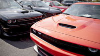 Several Dodge Challengers sit on display at Bettenhausen Motor Sales Jeep Chrysler Dodge RAM in Tinley Park, Ill., in September. MUST CREDIT: Bloomberg photo by Daniel Acker