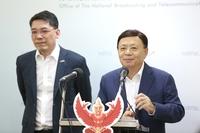 NBTC secretary-general Takorn Tantasith, right