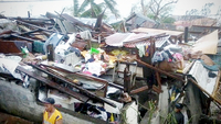 "NEIGHBORHOOD LOSS Residents of Barangay Culasi in Roxas City, capital of Capiz province, need to build again their homes following the fury unleashed by Typhoon ""Ursula"" on Christmas Eve. Six years ago, Supertyphoon ""Yolanda"" destroyed houses in the same neighborhood. —CONTRIBUTED PHOTO"