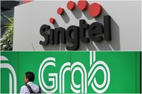 Grab will hold a 60 per cent stake in the consortium that they formed, while Singtel will hold the remaining 40 per cent. PHOTOS: ST FILE
