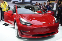 A Tesla Model 3 sedan is displayed during an auto expo in Beijing. [Photo provided to China Daily]