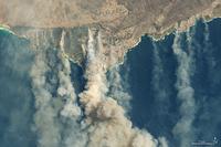 Burned land and thick smoke over Kangaroo Island, Australia, January 9, 2020. MUST CREDIT: NASA Earth Observatory photo